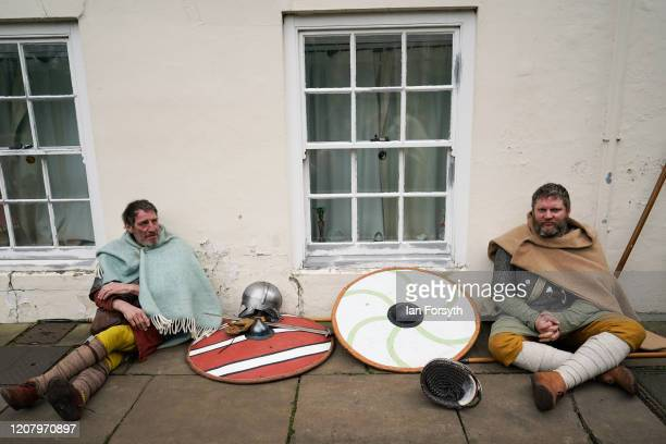 Viking reenactors sit on the floor as they wait to march through York as part of the 36th York Viking Festival on February 22 2020 in York England...