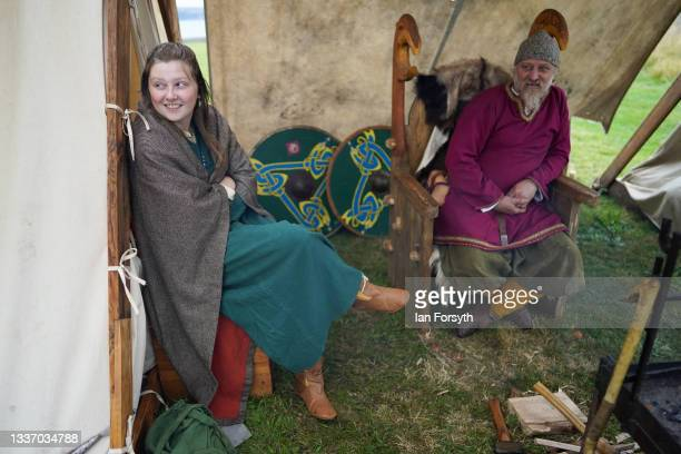 Viking re-enactors sit outside their tents in the grounds of Whitby Abbey on August 29, 2021 in Whitby, England. Around 130 re-enactors gather at...