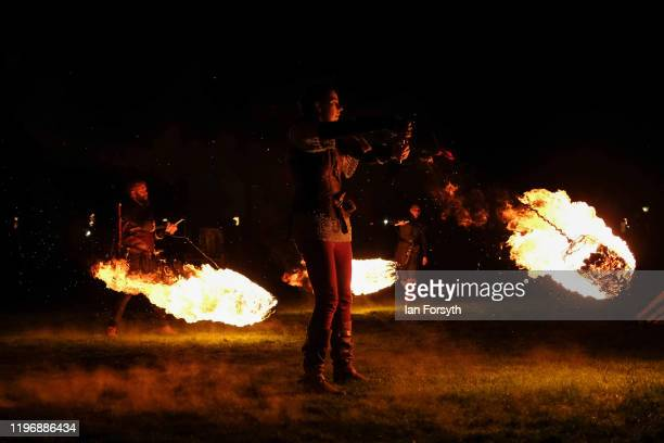 Viking reenactors swing fireballs during New Year's Eve celebrations at the Flamborough Fire Festival on December 31 2019 in Flamborough England Now...