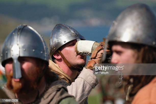 Viking reenactors take a break during skirmishes at the Viking Festival at Whitby Abbey on August 24 2019 in Whitby England Temperatures are expected...