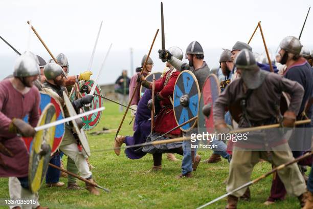 Viking re-enactors take part in a demonstration of fighting in the grounds of Whitby Abbey on August 29, 2021 in Whitby, England. Around 130...