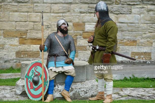 Viking re-enactors wait to begin a demonstration of fighting techniques in the grounds of Whitby Abbey on August 29, 2021 in Whitby, England. Around...