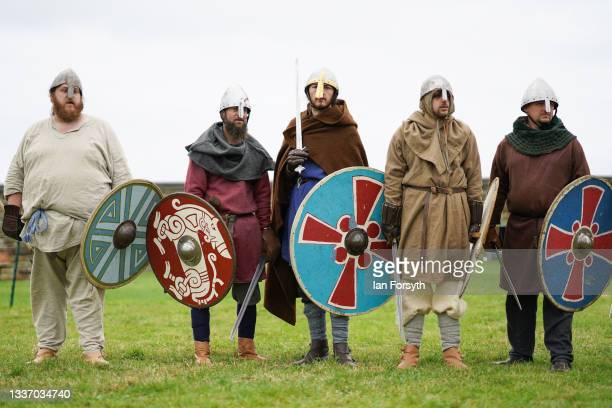Viking re-enactors wait to demonstrate fighting techniques in the grounds of Whitby Abbey on August 29, 2021 in Whitby, England. Around 130...