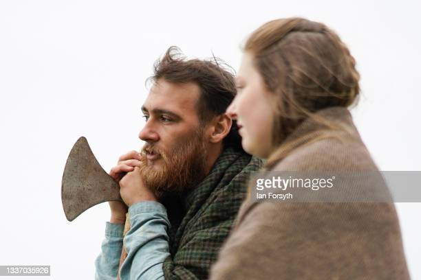 Viking re-enactors watch as a demonstration of skirmishing takes place in the grounds of Whitby Abbey on August 29, 2021 in Whitby, England. Around...