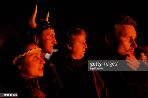 Viking reenactors watch as a longboat is burned during New Year's Eve celebrations at the Flamborough Fire Festival on December 31 2019 in...