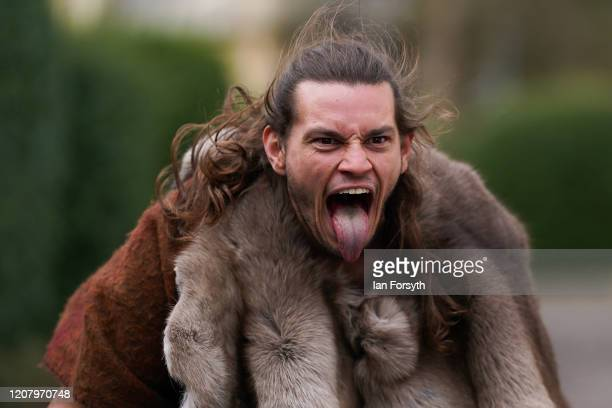 Viking reenactos pulls a face as he poses for pictures during a march through York as part of a living history display during the 36th York Viking...