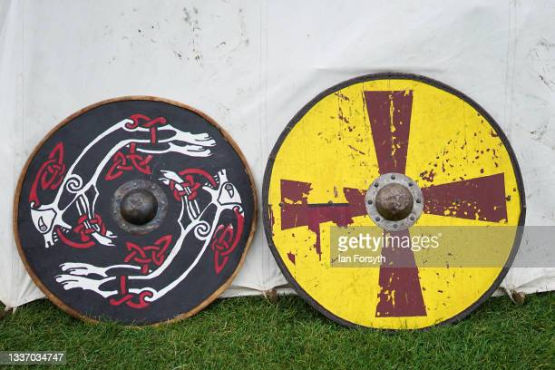 Viking shields rest against the side of a tent in the grounds of Whitby Abbey on August 29, 2021 in Whitby, England. Around 130 re-enactors gather at...