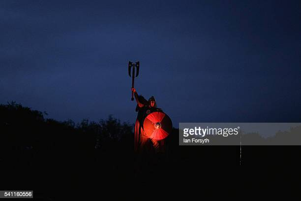 A viking stands on top of a hill during a battle as participants perform in a full dress rehearsal preview evening for the Kynren event an epic tale...