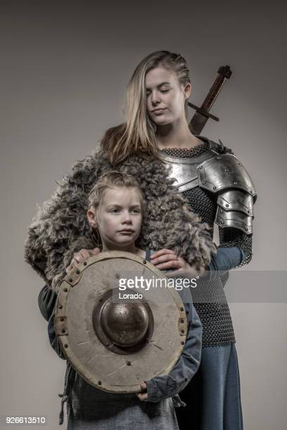 viking warrior family in studio shoot - film poster stock pictures, royalty-free photos & images