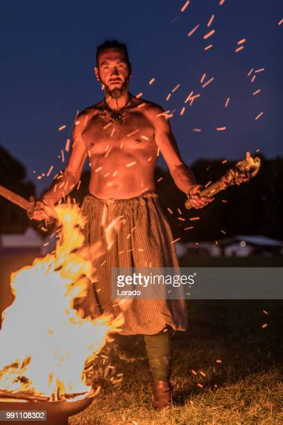 A viking warrior holding a fiery torch
