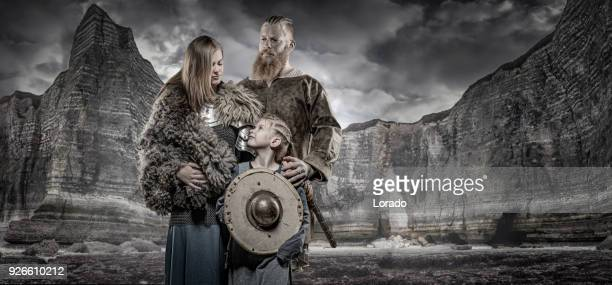 viking warrior king and princess in front of viking hoard and mountain range - film poster stock pictures, royalty-free photos & images