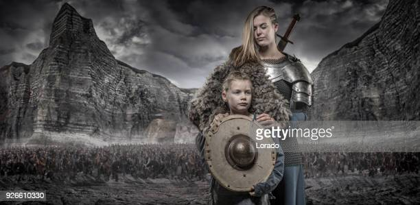 Viking warrior queen and princess in front of viking hoard and mountain range