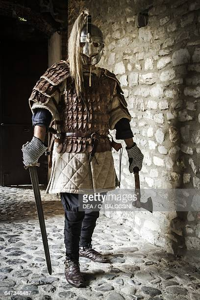 Viking warrior with helmet brigantina gambeson ax and sword Scandinavia 10th century Historical reenactment