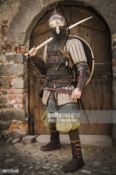 Viking warrior with helmet leather armour and gambeson sword and shield 10th century Historical reenactment