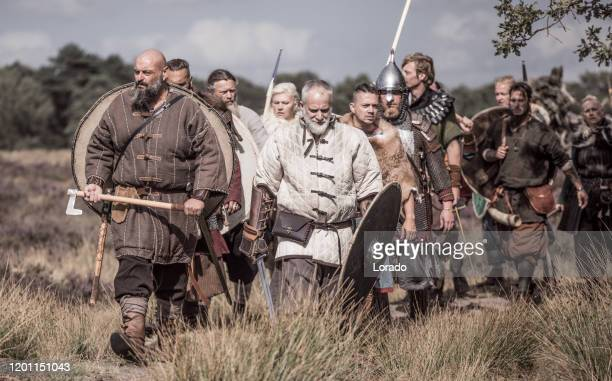 viking warriors outdoors leading a scouting mission - battlefield stock pictures, royalty-free photos & images