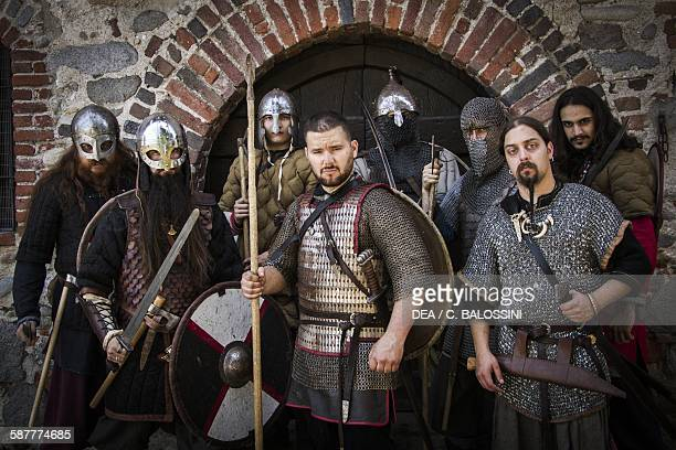 Viking warriors with weapons helmets and armour 10th century Historical reenactment