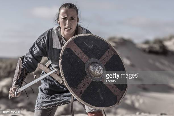 viking woman in the sand - shield stock pictures, royalty-free photos & images