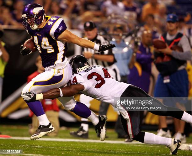 Vikings full back Ryan D'Imperio pushed Houston's corner back Dominique Barber away in the fourth quarter during Thursday night preseason action at...