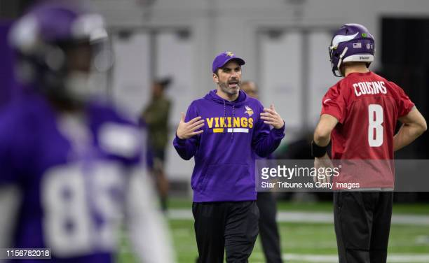 Vikings interim offensive coordinator Kevin Stefanski talked with quarterback Kirk Cousins during practice at Twin Cities Orthopedics Center Thursday...