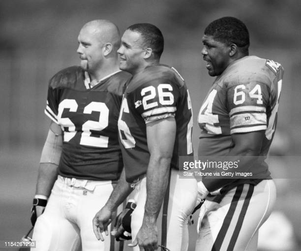 Vikings training camp #62 Jeff Christy #26 Robert Smith and Randall McDaniel watch teammates workout while taking a breather during Viking camp...