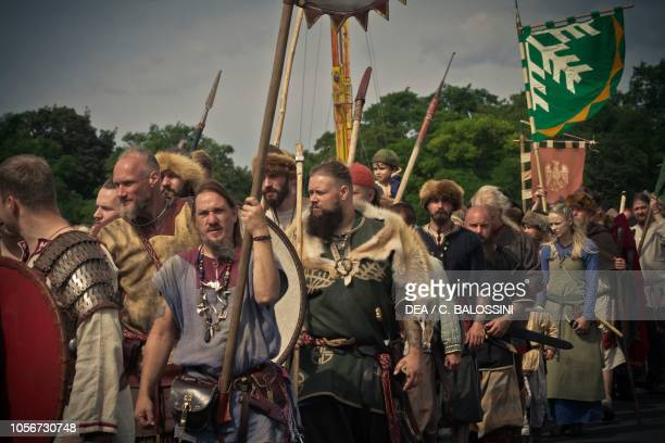 Vikings with spears and shields Festival of Slavs and Vikings Centre of Slavs and Vikings JomsborgVineta Wolin island Poland Slavic and Viking...