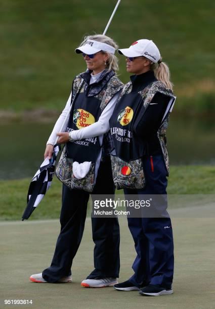 Vikki Carol Langer and Melissa Lehman work as caddies during the final round of the PGA TOUR Champions Bass Pro Shops Legends of Golf at Big Cedar...