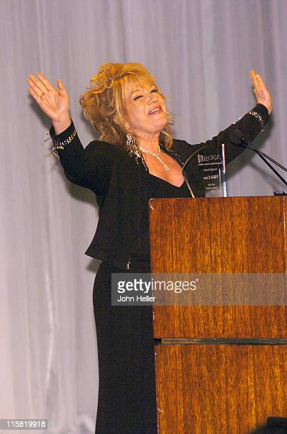 Vikki Carr accepts her NHMC Liftime Achievement Award