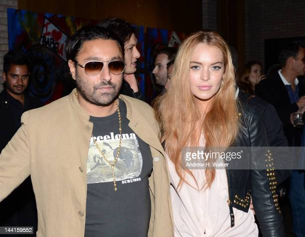 Vikram Chatwal and Lindsay Lohan attend the Domingo Zapata Life Is A Dream Art Exhibition at Dream Downtown on May 10 2012 in New York City