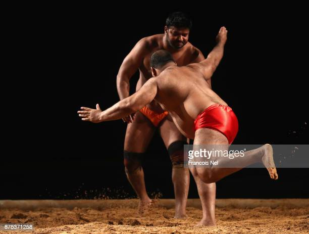 Vikram Pahelwan and Shahzad Pahelwan of Pakistan competes during The IndoPak Kushti Wrestling Championship at Hamdan Sports Complex on November 17...