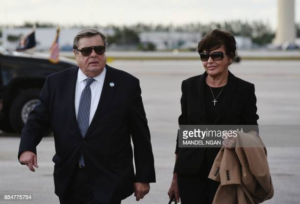 Viktor and Amalija Knavs the parents of US First Lady Melania Trump are seen on the tarmac after they stepped off Air Force One upon arrival at Palm...