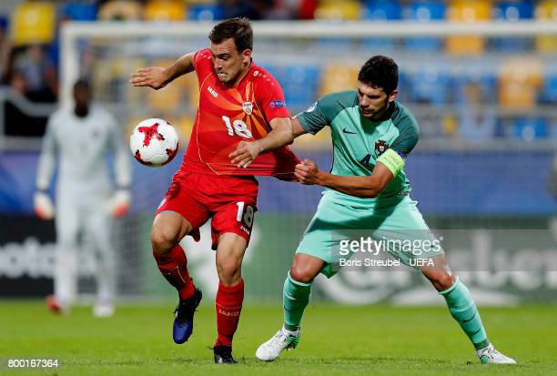 Viktor Angelov of FYR Macedonia is challenged by Tobias Figueiredo of Portugal during the UEFA European Under21 Championship Group B match between...