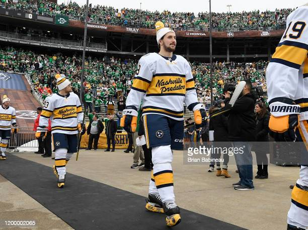 Viktor Arvidsson and Filip Forsberg of the Nashville Predators walk to the ice for warmup prior to the 2020 NHL Winter Classic between the Nashville...