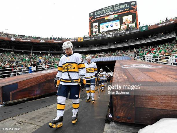 Viktor Arvidsson and Ryan Johansen of the Nashville Predators walk toward the ice surface for the third period of the 2020 NHL Winter Classic between...