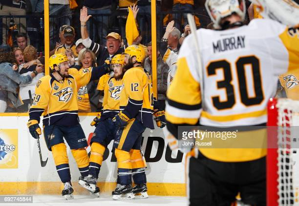 Viktor Arvidsson celebrates his goal with Roman Josi and Mike Fisher of the Nashville Predators against Matt Murray of the Pittsburgh Penguins during...
