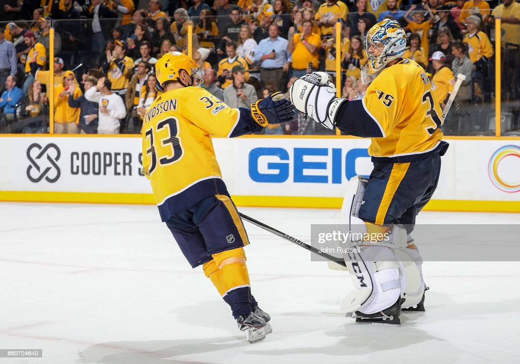 Viktor Arvidsson #33 congratulates Pekka Rinne #35 of the Nashville Predators after a 4-1 win against the Dallas Stars during an NHL game at Bridgestone Arena on October 12, 2017 in Nashville, Tennessee.