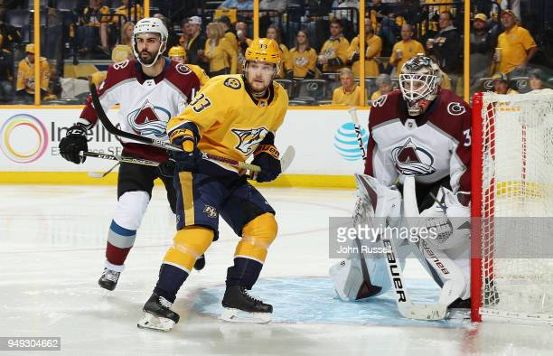 Viktor Arvidsson of the Nashville Predators battles between Mark Barberio and Andrew Hammond of the Colorado Avalanche in Game Five of the Western...