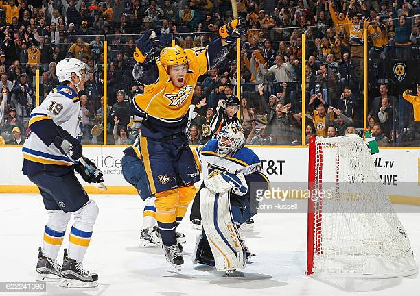 Viktor Arvidsson of the Nashville Predators celebrates a goal against Carter Hutton and Jay Bouwmeester of the St Louis Blues during an NHL game at...