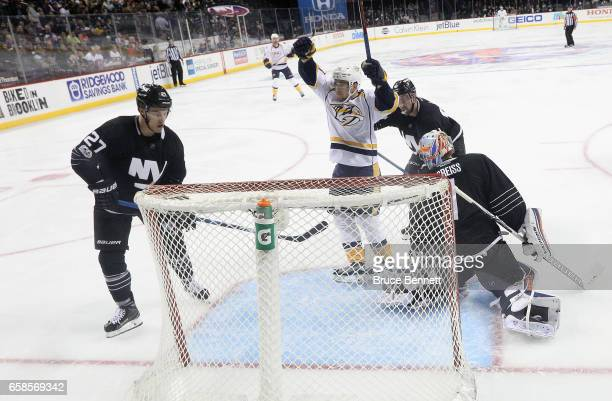 Viktor Arvidsson of the Nashville Predators celebrates his goal at 3:15 of the second period against the New York Islanders at the Barclays Center on...
