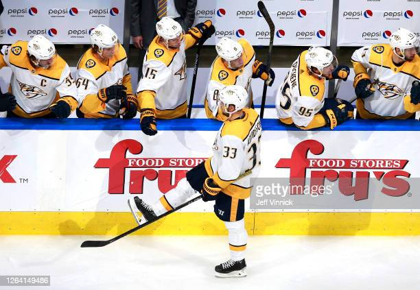 Viktor Arvidsson of the Nashville Predators celebrates his goal with teammates on the bench in the second period against the Arizona Coyotes in Game...
