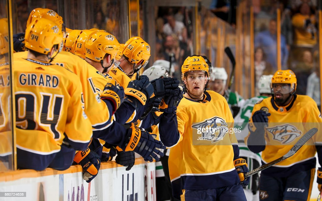 Viktor Arvidsson #33 of the Nashville Predators celebrates his goal with the bench against the Dallas Stars during an NHL game at Bridgestone Arena on October 12, 2017 in Nashville, Tennessee.