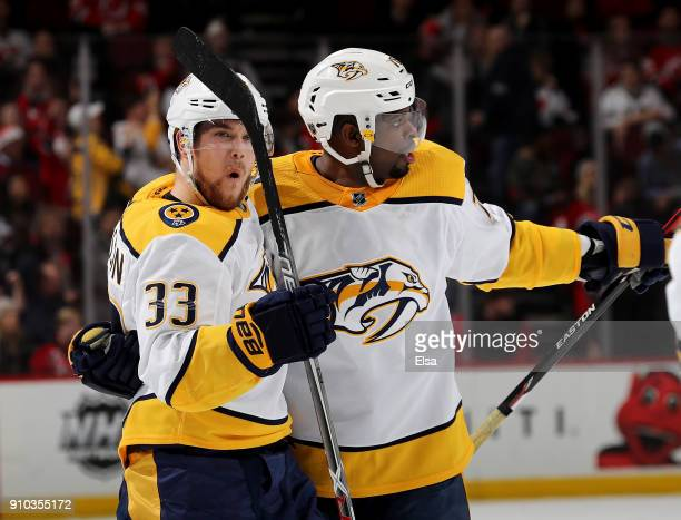 Viktor Arvidsson of the Nashville Predators celebrates his short handed goal with teammate PK Subban in the third period against the New Jersey...