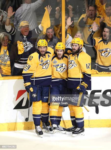 Viktor Arvidsson of the Nashville Predators celebrates with his teammates after scoring a goal on Matt Murray of the Pittsburgh Penguins during the...