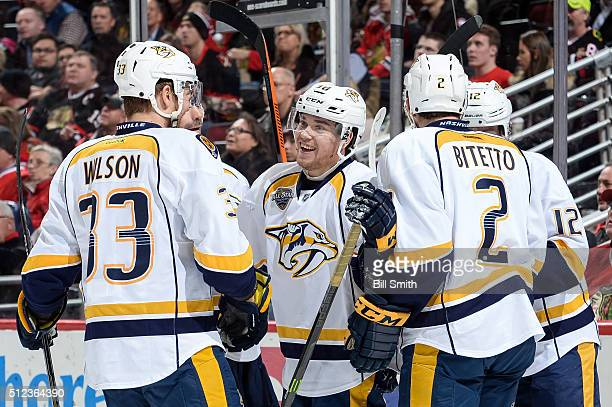 Viktor Arvidsson of the Nashville Predators celebrates with teammates after scoring in the second period of the NHL game against the Chicago...