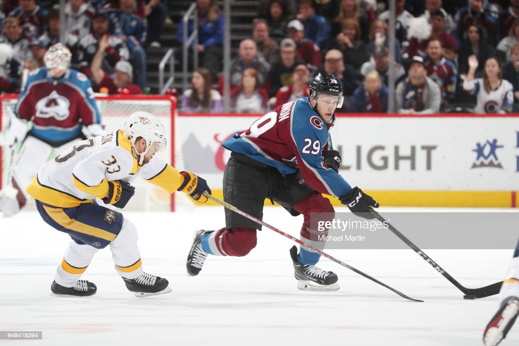 Viktor Arvidsson #33 of the Nashville Predators defends against Nathan MacKinnon #29 of the Colorado Avalanche in Game Four of the Western Conference First Round during the 2018 NHL Stanley Cup Playoffs at the Pepsi Center on April 18, 2018 in Denver, Colorado. The Predators defeated the Avalanche 3-2.