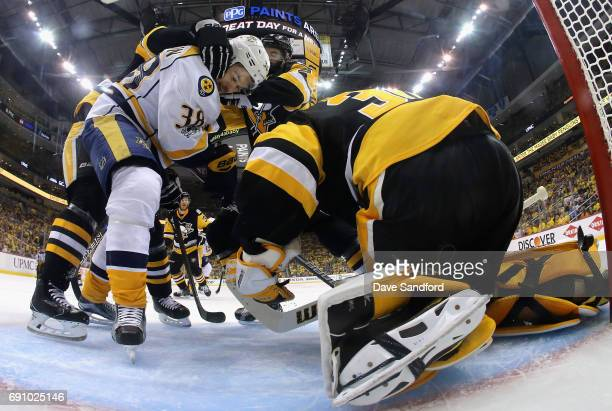 Viktor Arvidsson of the Nashville Predators is grabbed in front of goaltender Matt Murray of the Pittsburgh Penguins during the second period of Game...