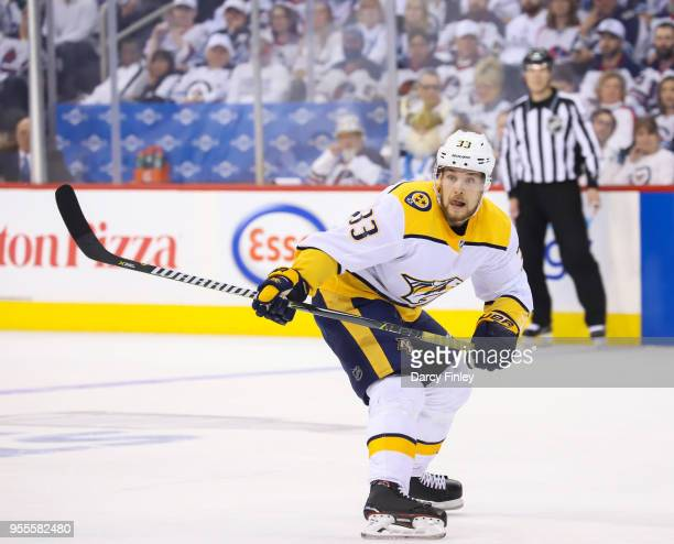 Viktor Arvidsson of the Nashville Predators keeps an eye on the play during second period action against the Winnipeg Jets in Game Four of the...