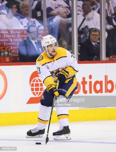 Viktor Arvidsson of the Nashville Predators plays the puck down the ice during third period action against the Winnipeg Jets in Game Four of the...