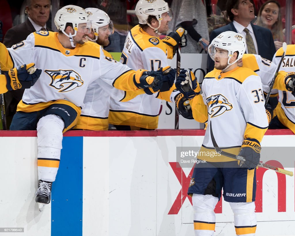 Viktor Arvidsson #33 of the Nashville Predators pounds gloves with teammates on the bench following his third period goal during an NHL game against the Detroit Red Wings at Little Caesars Arena on February 20, 2018 in Detroit, Michigan.