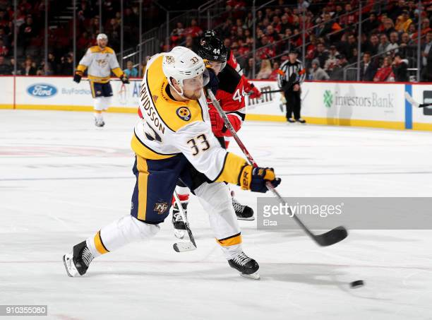 Viktor Arvidsson of the Nashville Predators scores a short handed goal as Miles Wood of the New Jersey Devils defends in the third period on January...