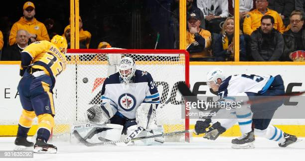 Viktor Arvidsson of the Nashville Predators scores a shorthanded goal against Michael Hutchinson of the Winnipeg Jets during an NHL game at...